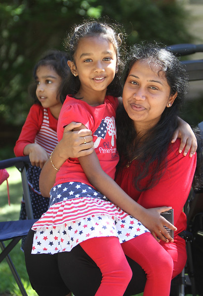 50th anniversary of Chelmsford's 4th of July celebration and parade. Priya Saravanan with daughters Madhura, 6, and Thanura, 4, rear. (SUN/Julia Malakie)