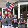 50th anniversary of Chelmsford's 4th of July celebration and parade. From left, Jim Francis, Jeannette Leger, Jim's wife Mary Francis, Jeannette's husband Paul Leger, and partners Ali Keir and Mihai Popa, all neighbors, gathered to watch parade at the Legers' house. (SUN/Julia Malakie)