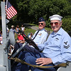 50th anniversary of Chelmsford's 4th of July celebration and parade. Air Force veteran George Merrill of North Chelmsford, left, and Navy vet Sandy Shepherd of Westford, ride in a Navy jeep. (SUN/Julia Malakie)