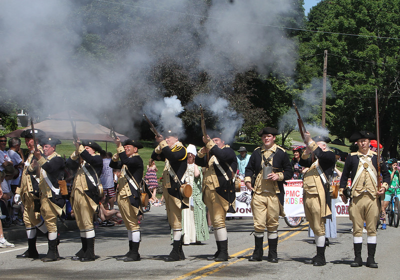 50th anniversary of Chelmsford's 4th of July celebration and paradel. Lexington Minute Men fire muskets. (SUN/Julia Malakie)