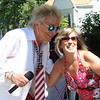 50th anniversary of Chelmsford's 4th of July celebration and paradel. Rod Stewart impersonator stops for a photo with Linda Maggiacomo of Dracut. (SUN/Julia Malakie)