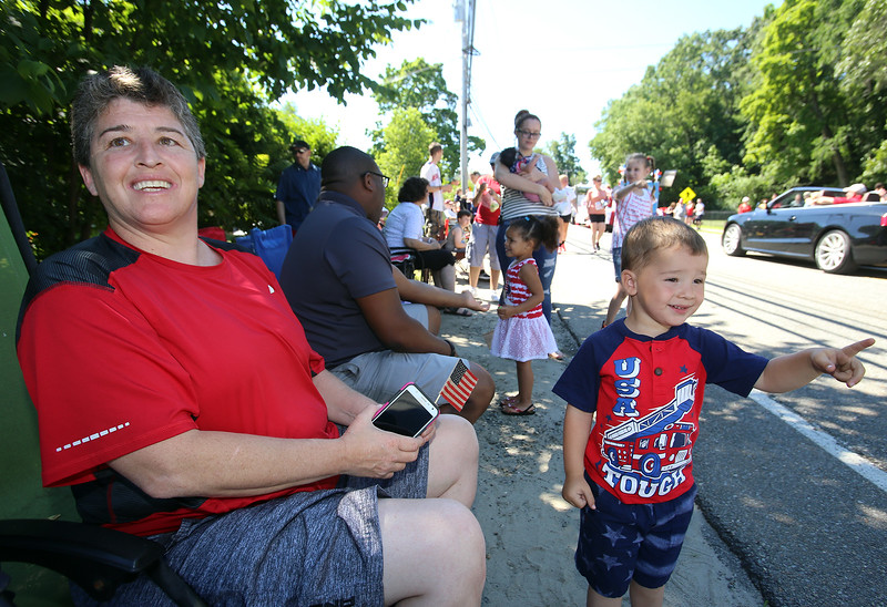 50th anniversary of Chelmsford's 4th of July celebration and parade. Sharon Thomas of Pawtucket watches parade with her grandson Adonis Thomas, 2-1/2, also of Pawtucket. (SUN/Julia Malakie)