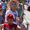 Chelmsford 4th of July parade. Kathy Ingles of Scottsdale, Arizona, with her grandson Rowan Ingles, 5, of Chelmsford, right, and possibly a friend, left. (SUN/Julia Malakie)