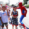 Chelmsford 4th of July parade. Ricky Pagan, 10, and his sister Emily Pagan, 9, of Chelmsford watch the parade as Spiderman passes by. (SUN/Julia Malakie)