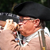 Chelmsford 4th of July parade. Sgt. Jim Curley of Chelmsford, with the Chelmsford Minutemen, takes a drink during a pause in marching.  (SUN/Julia Malakie)