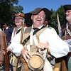 Chelmsford 4th of July parade. John Barrett of Townsend, second from right, recaps his canteen during pause in marching with Chelmsford Minutemen. (SUN/Julia Malakie)