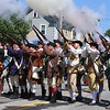 Chelmsford 4th of July parade. Chelmsford Minutement fire their muskets.  (SUN/Julia Malakie)