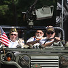 From left, veterans Joe Zangri of Billerica, Jean Pinard of Dracut, and Peter Milo of Pelham, N.H., in jeep in Chelmsford 4th of July parade.  (SUN/Julia Malakie)