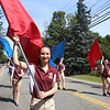 Mia Demoulpied, 17, rising senior at Chelmsford High School, with CHS marching band in Chelmsford 4th of July parade.  (SUN/Julia Malakie)