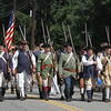 Chelmsford Minutemen march in Chelmsford 4th of July parade.  (SUN/Julia Malakie)