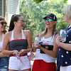 Chelmsford 4th of July parade. From left, Maggie Higgins, 15, her friend Jules Madsen, 14, Madsen's mom Kerry Madsen, and Sue Poor, all of Chelmsford, before the parade. (SUN/Julia Malakie)