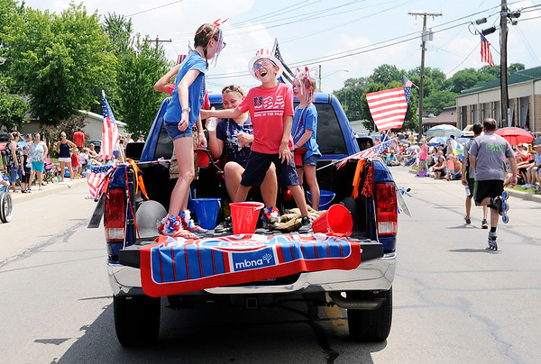 Don Knight | The Herald Bulletin<br /> Kids dance in the Badger Live Bait and Tackle entry in Chesterfield's Fourth of July parade on Wednesday.