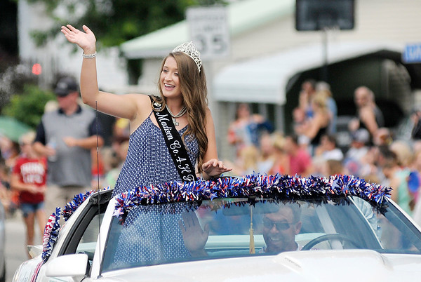 Don Knight   The Herald Bulletin<br /> Madison County 4-H Fair Queen Marlee Hobbs waves to the crowd during Chesterfield's Fourth of July parade on Wednesday.