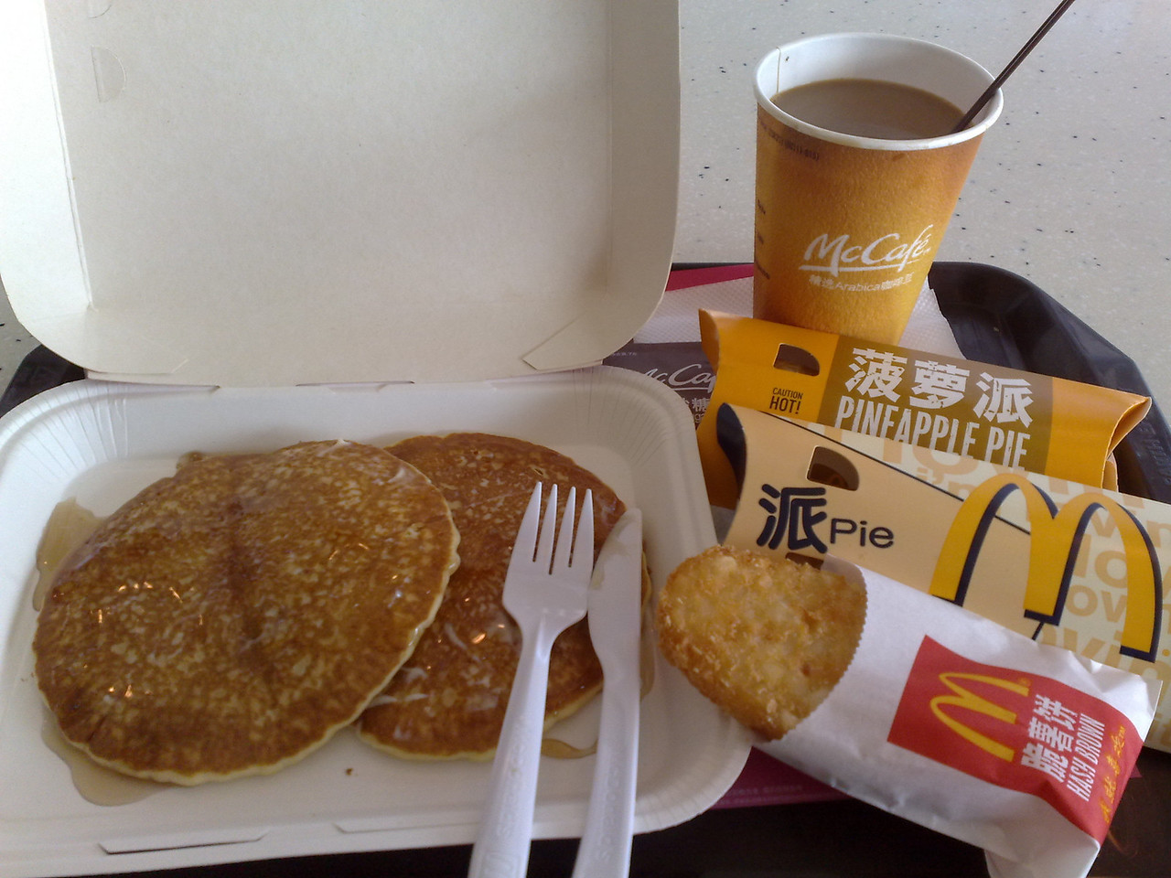 20090902_927 Breakfast at McDonald's. Hotcakes were about 10 RMB (less then $2AUS). The two pies were 7 RMB (for two), including a mango pie. The hash brown was gratis.