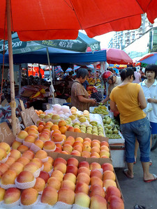 20090831_880 Fruit sellers in Guangzhou are very keen and competitive. Just walking by, many will call out, in Cantonese, about the freshness etc. of their product. Many, but not all, advertise at least some prices in front of their produce. Unfortunately, they all use old-fashioned scales and balances, rather than electronic balances. Overall, fruit prices here were cheaper than in Xi'an, Chengdu or Kunming. Quite often, fruit of different ages but of the same type were sold at different prices e.g. 1.0, 1.2 and 1.5 RMB per jin (pound) for bananas.