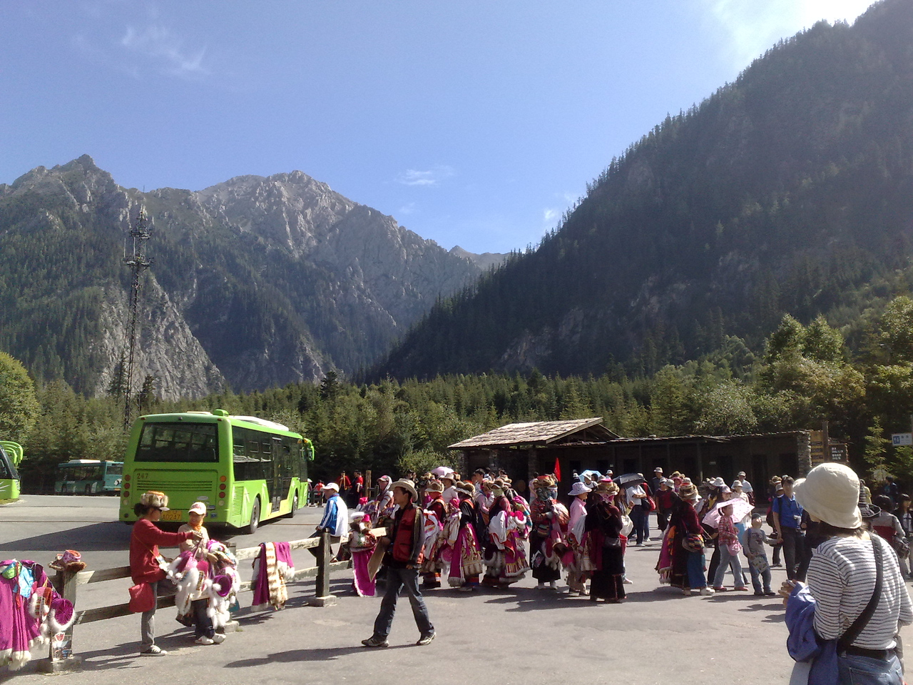 20090824_1016_0771 The last bus-stop of the slightly-less-commonly visited Zechawa Valley. Yes, that is a big horde of locals waiting at the bus-stop, waiting to pounce on the tourists as they alight off the bus.