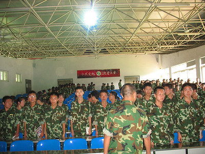 20090814_1458_6666 We had an opportunity to present lectures/talks on two separate days at a health sciences school a short distance outside Xi'an. We presented our talks during the 'summer break' when new university students are doing military training. The students are filing into the lecture hall in this picture.