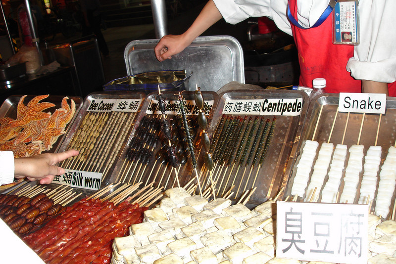 Yum, starfish, silkworm, bee coccoons, beetles, centipedes and snakes.  They were selling too!