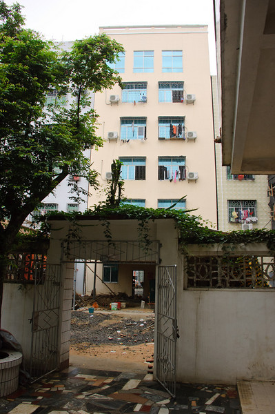 When we visited in 2006 those buildings weren't there.  In fact there was an open field outside Tong's parent's place.