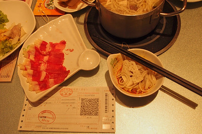 20130504_1847_4396 My first victory at the Xi'an Restaurant receipt lottery! At an underground fast-food/hotpot restaurant next to ZhongLou (Bell-Tower 钟楼) subway station. Thanks to Dr Kim for correctly identifying the value of the lottery (20RMB, written with financial Chinese Characters).  Unfortunately, the staff were not keen to re-imburse me the amount directly, which is common practice in Xi'an, and instead directed us to the instructions (written in Chinese) on the back of the receipt. Turns out that re-imbursement is by SMSing the tax department, which then adds some money to your mobile telephone account. Not very useful for short-term visitors to China!