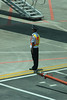 Guard standing to attention at Stand 11 of Fuzhou Changle International Airport as Air China B-5525 taxis in.