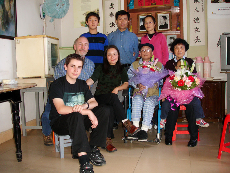 This was very soon after we arrived.  Jie Jie & Yen Son gave us the flowers when we arrived - they were a quite stunning display.  The portraits behind us are Tong's father's family.