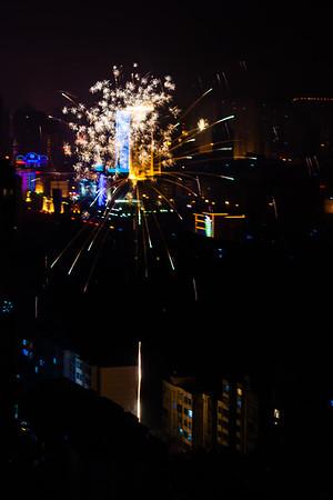 Exploding fireworks over residential buildings.