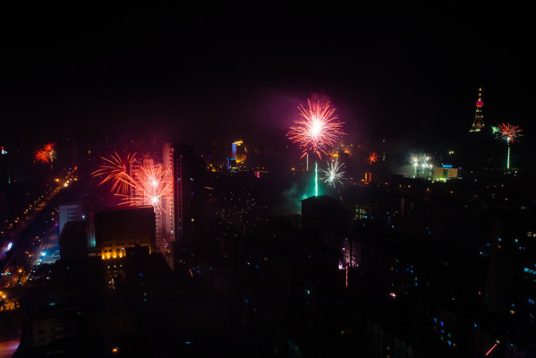 Fireworks (foreground left) are even set off in an apartment complex right behind a police station.
