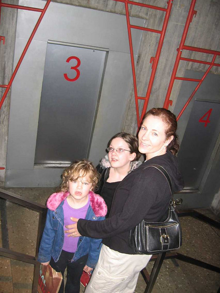 Three girls go up in the Arch.