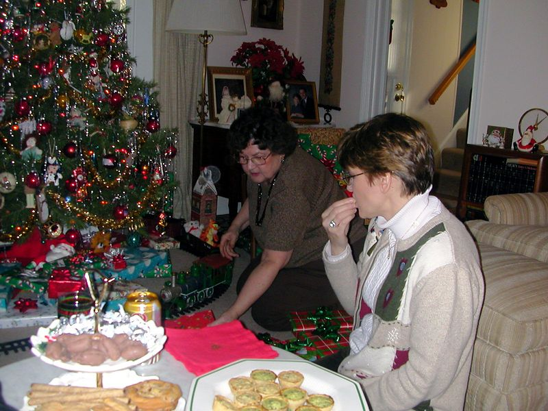 Karen and Mom start passing out presents.