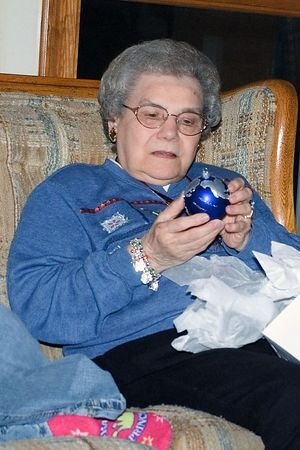 <br><br><font size=3>Grandma get's a special ornament for her tree.</font>
