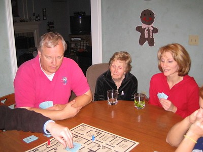 Dad, Grandma, and mom playing 'Kill Dr. Lucky'.