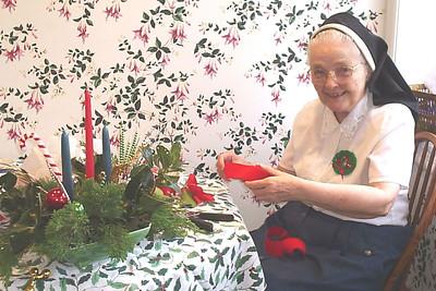 Aunt Pudgy makes the flower arrangement