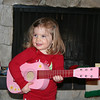 Brenna plays us a Christmas tune on her new guitar