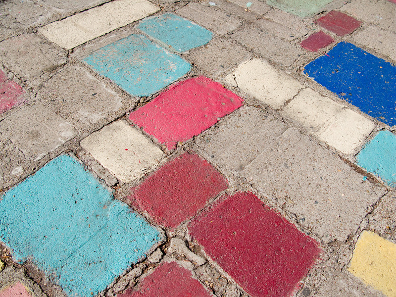 Beautiful pastel colors decorate the stone work in the artists village, Balboa Park, San Diego.