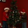 Kieran and Brenna put ornaments on their Christmas tree