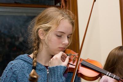 Claudia tuning Arayana's violin.