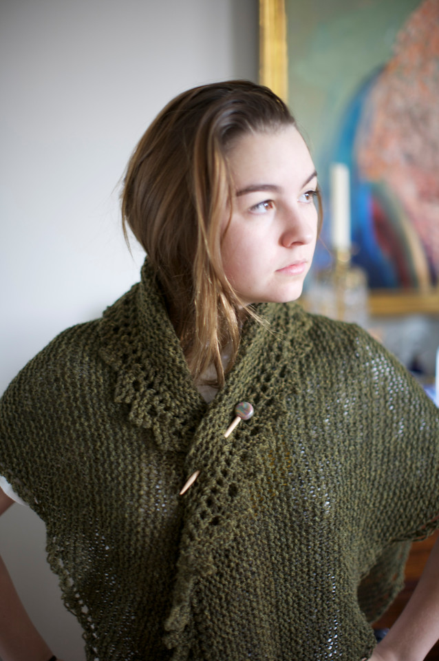 Abby in a shawl knitted by my mom. Note the shawl pin. I had no idea these existed.