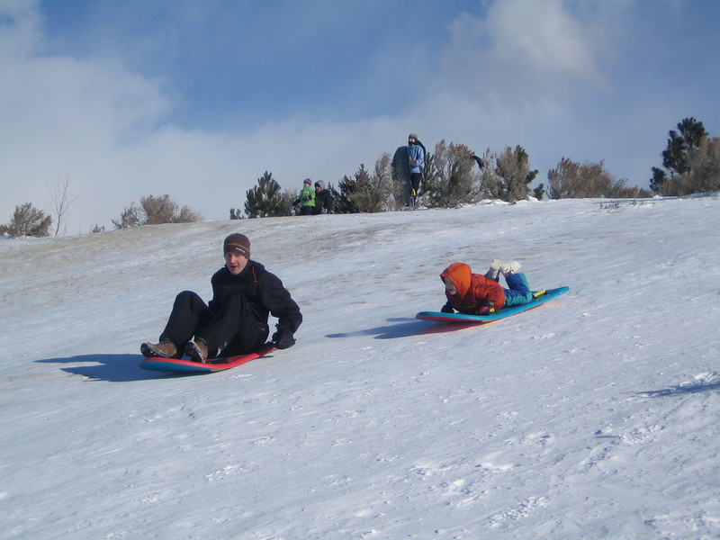 Jared and George race down the hill.