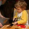 Kieran carefully slides his Christmas cookie on to the baking sheet