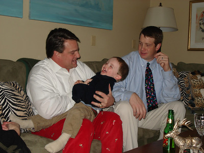 Alex getting attacked by the tickle monster...aka Uncle Johnny