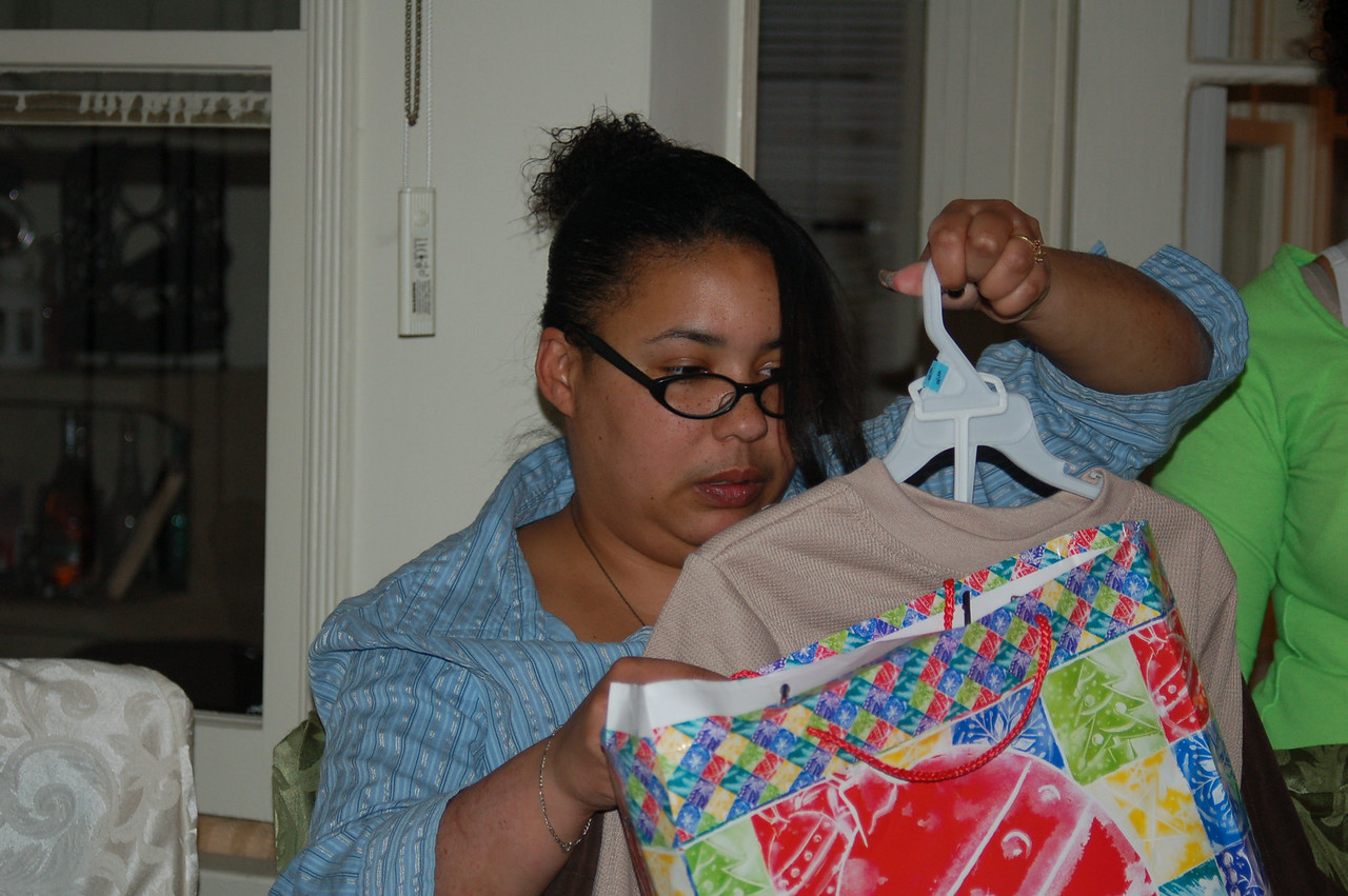 Daughter-in-law Felicia admiring a gift.