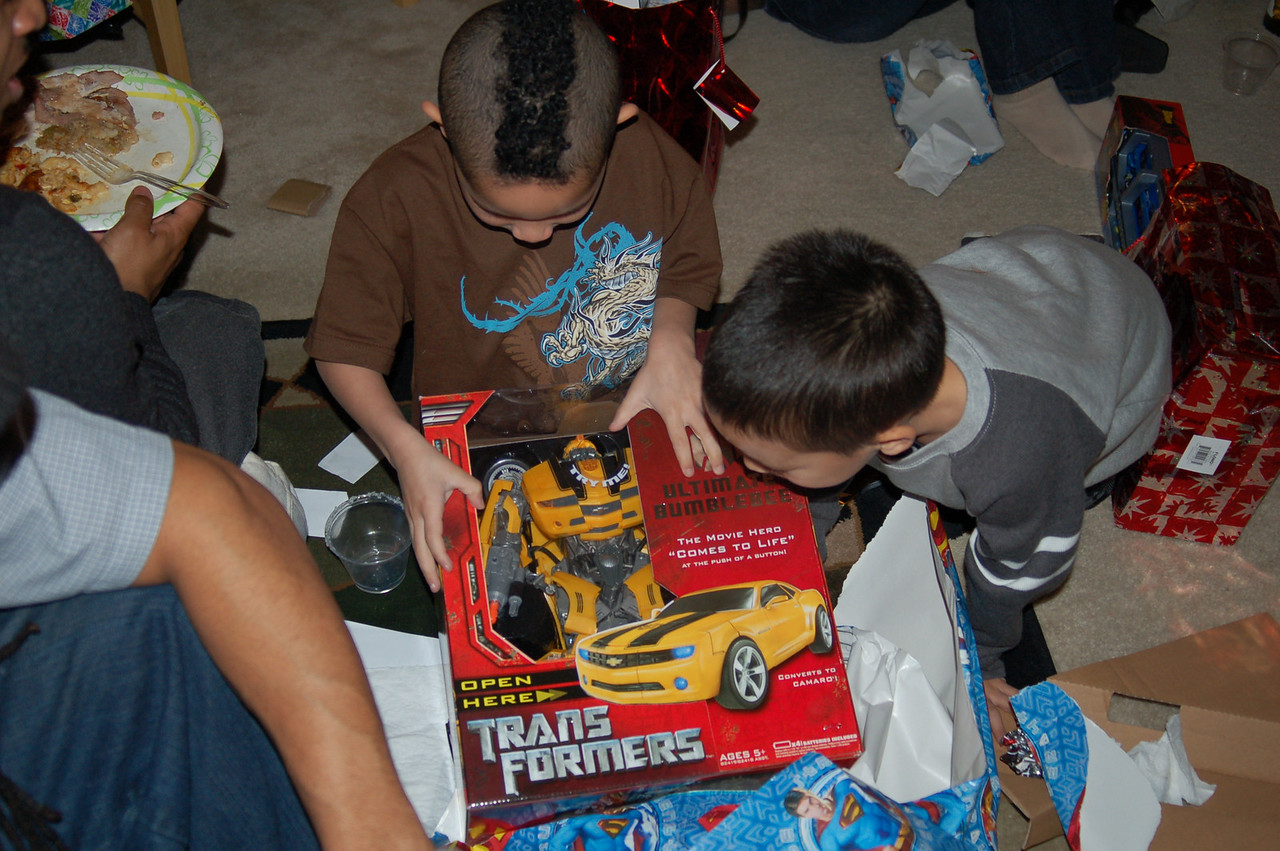 Rene (right) and and grandson Amiri (Mohawk haircut) are excited about their Transformer.