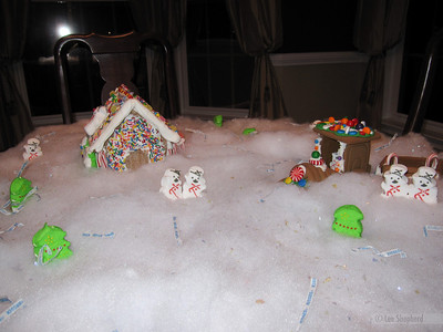 The village, complete with trees, snowmen and the flags off all the hershey kisses we used while baking.  (That was Madeline's idea.)