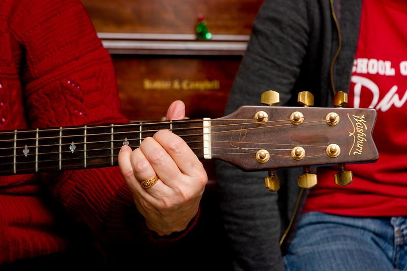 Rosewitha playing guitar.