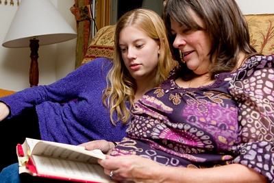 Mom and Ellie looking through the book of Christmas Carols.