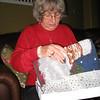 Susan opening gifts