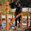 Flora standing on a footbridge she helped build, near the intersection of Middle Fork Road and Toms Falls Road.