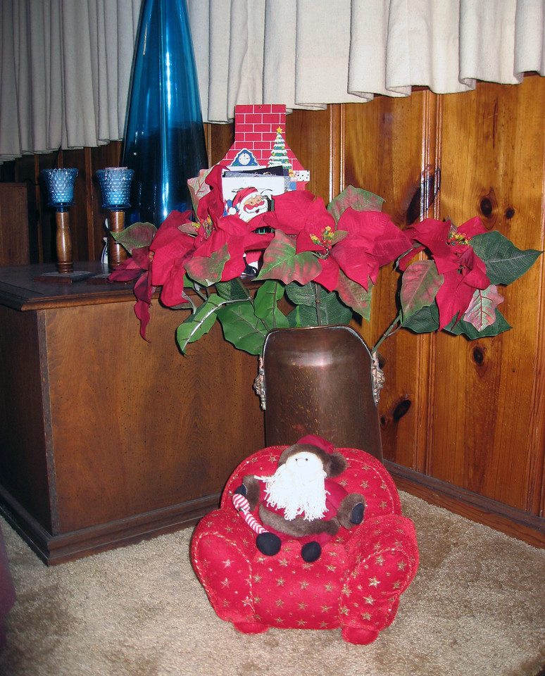 Dec 23.  Gmom put out Santa in his chair too: the Santa from Louise, and the chair from Jo Ann, some years ago.
