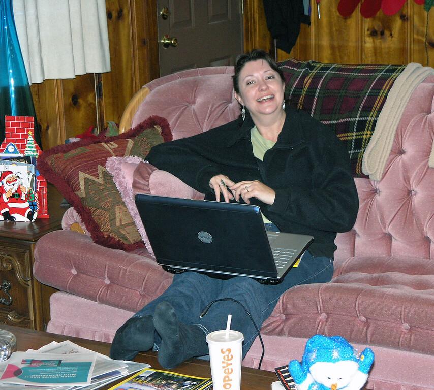 Dec 23.  Jo Ann works on her computer.